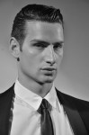 Black Jacket by Gucci, white dress shirt by , Henrik Vibskov; Photography Leonardo Vecchiarelli