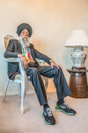 Suit by Material from Liberty of London  (Bespoke design & hand-tailored in Panjab, India);           Shirt by TM Lewin;            Socks by Tabio;            Shoes by  custom made for Fauja Singh by Adidas;           Tie by TM Lewin;           Turban by Pagreewala (Delhi, India);            Watch by Breitling; Photographer  Jasdip Sagu