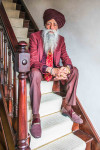 Suit  by Raymond (Delhi, India);            Shirt by Material from Liberty of London (Bespoke design & hand-tailored in Panjab, India);             Socks by Tabio;            Shoes by  Artisanal in Milan, Italy;             Tie by Bespoke design & hand-tailored in Amritsar, India           Turban by Pagreewala (Delhi, India);             Watch by Breitling; Photographer  Jasdip Sagu