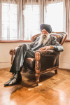 Suit by Material from House of Tartan in Scotland (Bespoke design & hand-tailored in Panjab, India);             Shoes by Church's;              Tie by TM Lewin;             Turban by Pagreewala (Delhi, India); Watch by Breitling; Photographer  Jasdip Sagu
